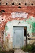 Broken defect desolate door ruin red barracks Stock Photos