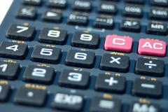 Computer keyboard out focus pocket calculator Stock Photos