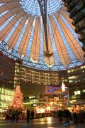 Stock Photo of christmas tree roof sony center berlin market