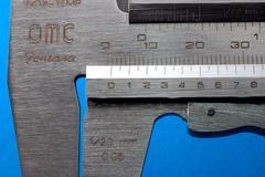 mark measure steel caliper calliper square exact - stock photo