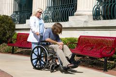 Nurse disabled patient Stock Photos
