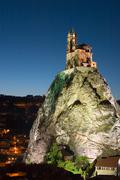 night exposure church rock france le puy point - stock photo