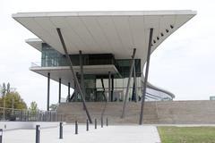 base column concrete glass fassade lawn modern - stock photo