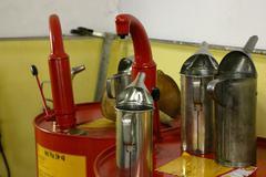 Car barrel garage mineral oil motor industry Stock Photos