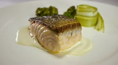 Gourmet restaurant food salmon muniere Stock Footage