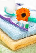 Toothbrush with toothpaste on fresh towels Stock Photos