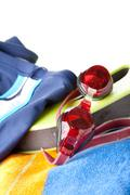swimming trunks, goggles and towel - stock photo