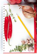 blank notepad with ingredients for your recipe - stock photo