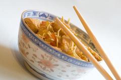 Blue bowl chopstick green health noodle paprika Stock Photos