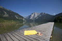 summer sun bath towel footbridge holiday lake - stock photo