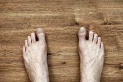 Man feet on parquet Stock Photos