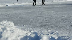 People skate slide ice outdoor frozen lake river cold winter day Stock Footage