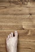 Left foot on parquet Stock Photos