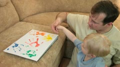 Father with son painting - stock footage