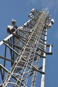 Telecommunication tower with steel ladder Stock Photos
