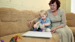 Granny and grandson at home Stock Footage