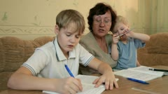 Grandma with grandsons at home Stock Footage