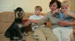 Grandmother with kids and pets at home Stock Footage