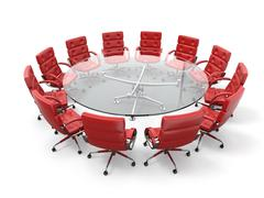 concept of business meeting or brainstorming. circle table and red armchairs. 3d - stock illustration