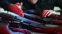 Selling guns weapon gun show Stock Footage