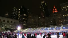 Ice skate rink in the city empire state building background 25p Stock Footage