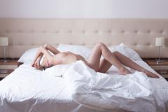 Image of passionate naked woman in bed Stock Photos