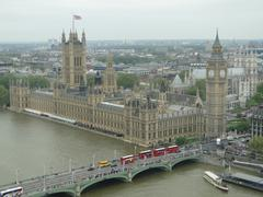 Houses of Parliament and four london Buses - stock photo