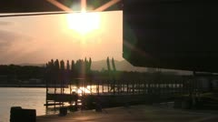 Sunset at trampoline entertainment next to Danube River (Vienna) Stock Footage