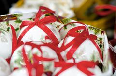Stock Photo of white collection of christmas balls with red ribons