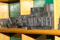 Stock Photo of typography letters shelf. old metallic letters for printing