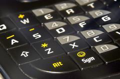 Modern black pha phone keyboard closeup soft focus asdf Stock Photos