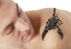 Man with scorpion Stock Photos