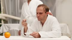 Morning Coffe in cozy spa center after bathroom Stock Footage