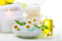 spa relaxation theme with flowers, bath salt, essential oil and candles - stock photo