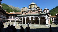 Rila Monastery, people in shadows - stock photo