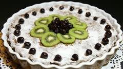 Stock Video Footage of ROTATING FOOD series - Close up of a Marasca cherry choco pie + kiwi