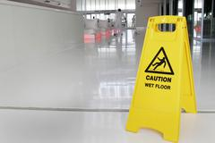 Warning sign caution wet floor signs decal label Stock Photos