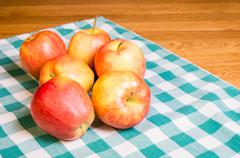 gala apples on checked cloth - stock photo