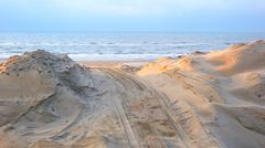 Beach dike for amplifying coast see landscape Stock Photos