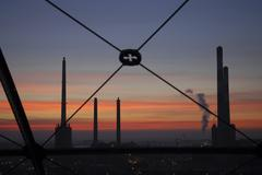 Design frame chimneys factory fumes sunset Stock Photos