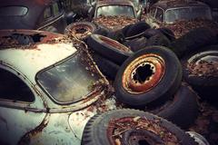 vintage auto graveyard - stock photo