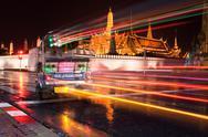 Bangkok night traffic - tuk tuk in front of the grand palace Stock Photos