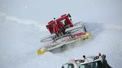 Snowcat runs on the mountain peak 8 Stock Footage