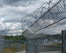 safety fence and dramatic sky - stock photo