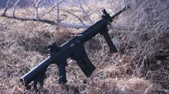 Ar-15 Leaning on a bush Stock Footage