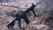 Stock Video Footage of Ar-15 Leaning on a bush