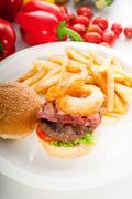 classic hamburger sandwich and fries - stock photo