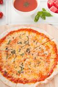 Italian original thin crust pizza Stock Photos