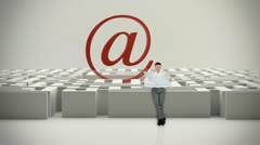 Businessman with Map trying to find his way in a Maze with Internet Mail Sign Stock Footage