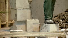 Worker at a construction site. Handling foam concrete blocks (AAC blocks). Stock Footage